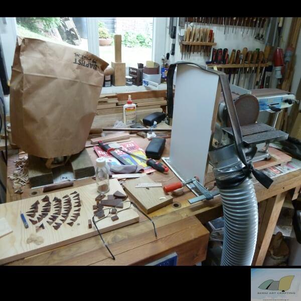 Werktafel met schuurmachine